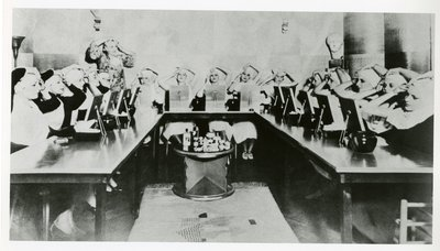 Beauty school class performing eye exercise