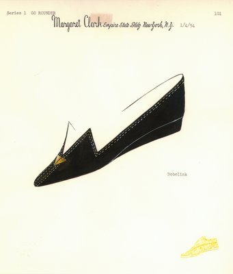 Jerry Miller black flat with gold arrowhead motif