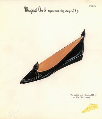 Jerry Miller black flat with shield-shaped applique