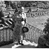 Helena Rubinstein by garden at her villa in Grasse, France